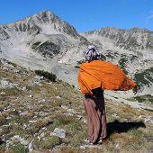 Young Tibetan Woman In A Rocky Mountain