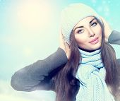 Beauty Winter Girl wearing hat and scarf. Winter holiday woman outdoor portrait