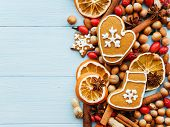 picture of christmas spices  - Christmas background nuts dried oranges spices and gingerbread cookies - JPG