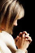 Young caucasian woman praying to Jesus