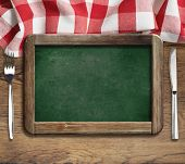 Menu green blackboard on table with knife and fork