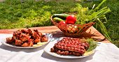 barbecue and grilled sausages with tomato and cucumber