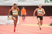 LINZ, AUSTRIA - JANUARY 30, 2014: Carina Horn (#409 Republic of South Africa) wins the women's 60m event in an indoor track and field meeting.