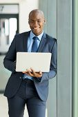 portrait of young african american business man with laptop