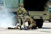 Military intervention, injured soldier.