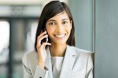 happy indian business woman talking on cell phone
