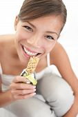 Woman Eating Muesli Bar Snack