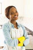 young african woman with arms crossed in the kitchen