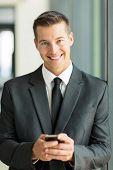 portrait of caucasian businessman using smart phone