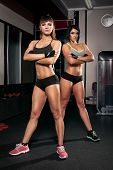 Two Sports Girl In The Gym