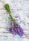 Lavender blossoms on wood, shot from upper view