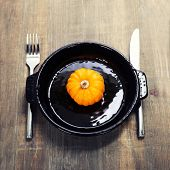 Autumn compositionwith pumpkin on a plate and autumn decorations. Thanksgiving day concept