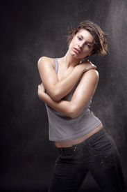 picture of strip tease  - Wet young woman with a gray top - JPG
