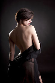 stock photo of curvy  - Sexy brunette woman wrapped with black tulle - JPG