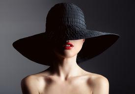 stock photo of dark-skin  - Beautiful woman in hat - JPG