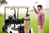pic of golf bag  - Golfer taking club in golf bag in golf course - JPG