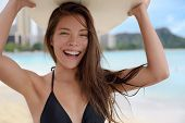 picture of woman bikini  - Surfer girl woman surfing having fun on Waikiki Beach - JPG