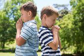 pic of pentecostal  - Little boys praying in the park on a sunny day - JPG