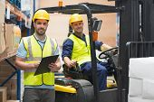 pic of worker  - Smiling warehouse worker and forklift driver in warehouse - JPG