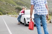 pic of breakdown  - Couple after a car breakdown at the side of the road - JPG