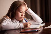 picture of homework  - Child doing homework - JPG