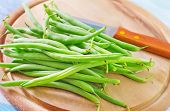 stock photo of green bean  - green beans on wooden board, raw beans