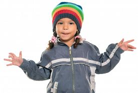 stock photo of rap-girl  - Mixed race little girl with a funny attitude wearing a colorful beanie hat and a jacket isolated on white - JPG