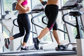 pic of cardio exercise  - Beautiful group of young women friends  exercising on a treadmill at the bright modern gym - JPG