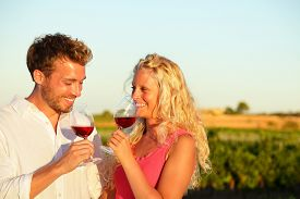 stock photo of alcoholic drinks  - Drinking red wine couple in love - JPG