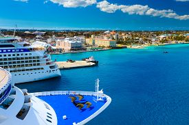 stock photo of oasis  - Cruise Ships in Nassau Bahamas port in natural light - JPG