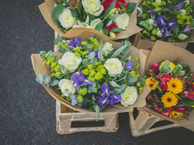 picture of stall  - A mixtures of different flowers displayed by a florist in a stall on the street - JPG