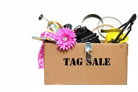 stock photo of yard sale  - A large cardboard box filled with Yard Sale or Tag Sale items to be sold at a discount in order to make room and make some money at the same time - JPG