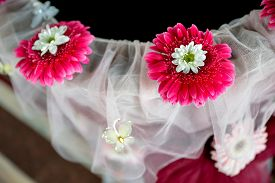 foto of baptism  - Baptismal font with veil and flowers in natural light  - JPG
