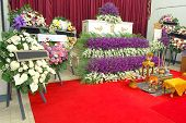 picture of funeral  - coffin and wreaths at a thai funeral - JPG