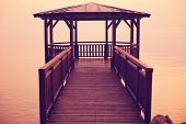 stock photo of pier a lake  - Capture of Pier on Garda lake with beautiful view - JPG
