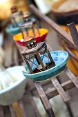 stock photo of flea  - Old rusty lanterns and pottery in a flea market - JPG