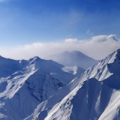 picture of snow capped mountains  - Snow mountains in early morning fog - JPG