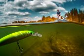 pic of ponds  - Split shot of the man fishing on the pond with plastic floating bait - JPG