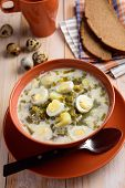 picture of quail  - Sorrel soup with boiled quail eggs on a rustic table - JPG