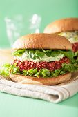 picture of veggie burger  - vegan beet and quinoa burger with avocado dressing - JPG