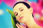 stock photo of bamboo leaves  - Beautiful woman with artistic make up and bamboo leaves - JPG