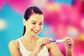 foto of pregnancy test  - Happy woman with positive pregnancy test - JPG