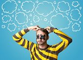 image of taboo  - Funny person with taped mouth and hand drawn clouds around head - JPG