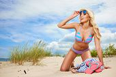 picture of funky  - Beach woman funky happy and colorful wearing sunglasses and beach hat having summer fun during travel holidays vacation - JPG