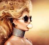 image of leopard  - High Fashion Model Girl Portrait wearing sunglasses - JPG