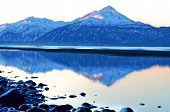 foto of snow capped mountains  - Morning light makes a snow capped mountain glow in places pink - JPG