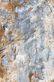 pic of gneiss  - rocks stone and red orange gneiss in the wall of morocco - JPG
