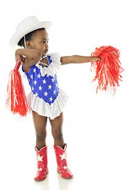 stock photo of pom poms  - An adorable two year old in a star studded red - JPG