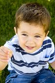 picture of little boy  - Cute little boy sitting in the grass - JPG