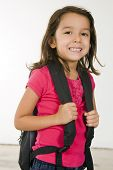Little girl with her book bag